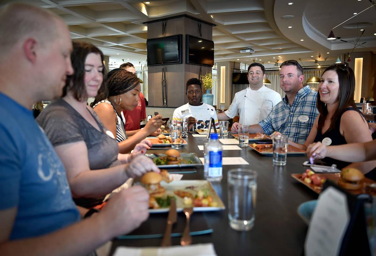 Herringbone restaurant chef Geno Bernardo, third from right, visits with customer during a Lip ...